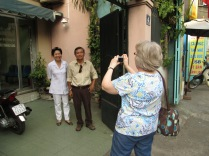 Lam's Mom and Dad in front of their house. Aunt Karen capturing the moment.