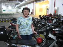 Aunt Karen next to David's bike. She loved riding this!
