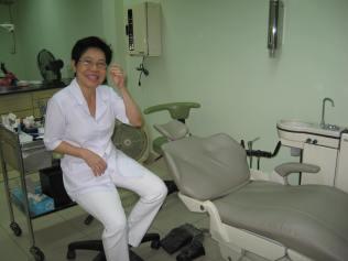 Lam's Mom in her dental clinic.