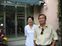 Lam's Mom and Dad in front of the clinic.