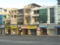 Stores/houses on a typical street in Vietnam.