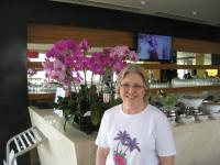 Aunt Karen with some lovely orchids in the hotel restaraunt.