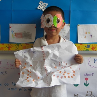 Jacob on the 100th day of school - with his 100 glasses he made and his 100 paint dobs (which he thinks looked like a butterfly)